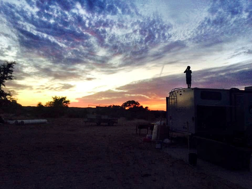 Tyler on top of trailer at sunset at IW - Oct2015.jpeg