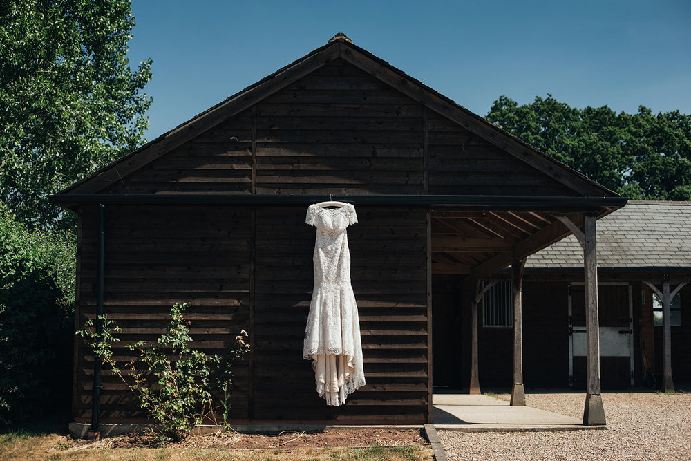 Wedding dress hanging on a barn