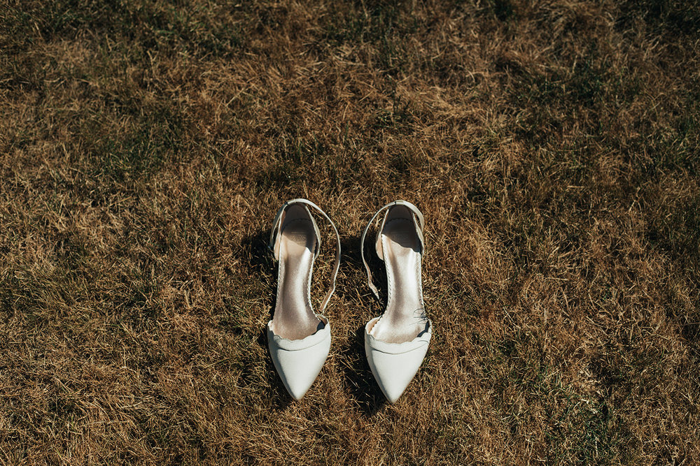Bride's shoes on grass