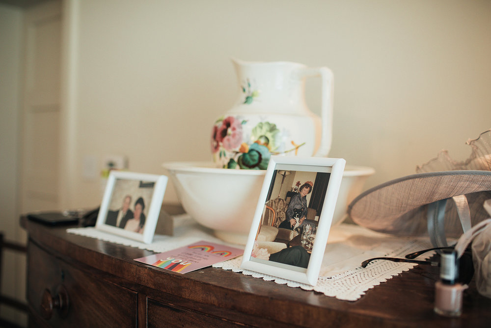 Framed photos of grandparents on dresser