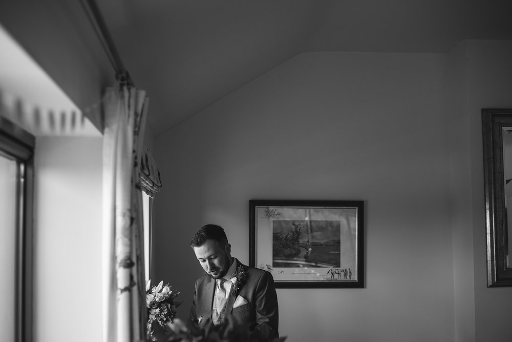 Groom i window light