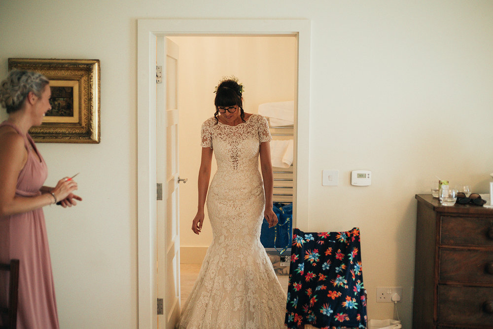 Bride revealing her Wedding dress