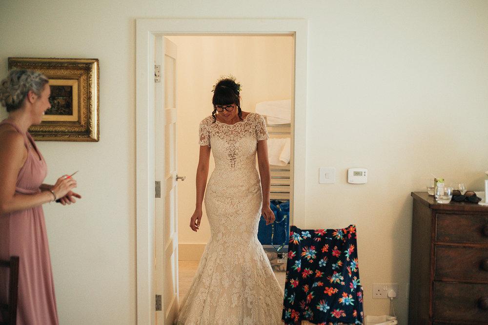 Bride revealing her Wedding dress