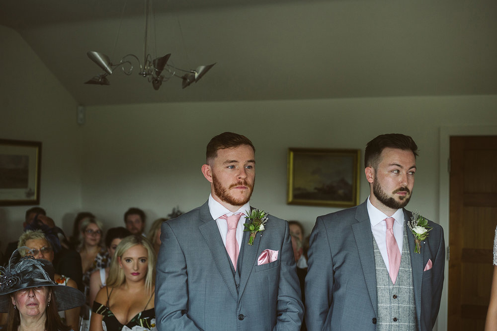 Best man and Groom at the alter