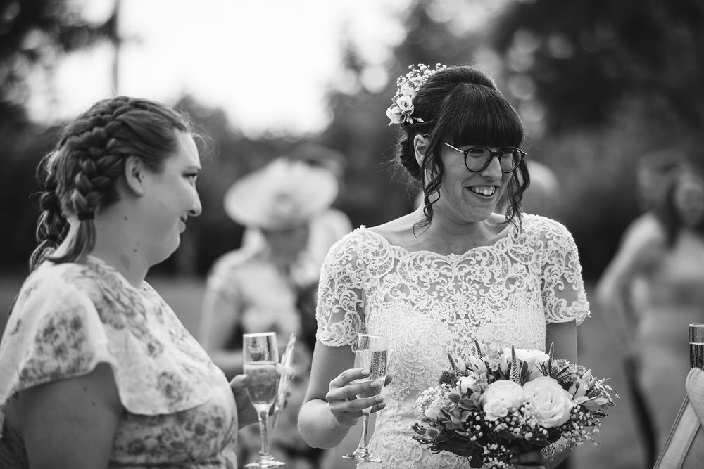 Bride smiling during cocktail hour
