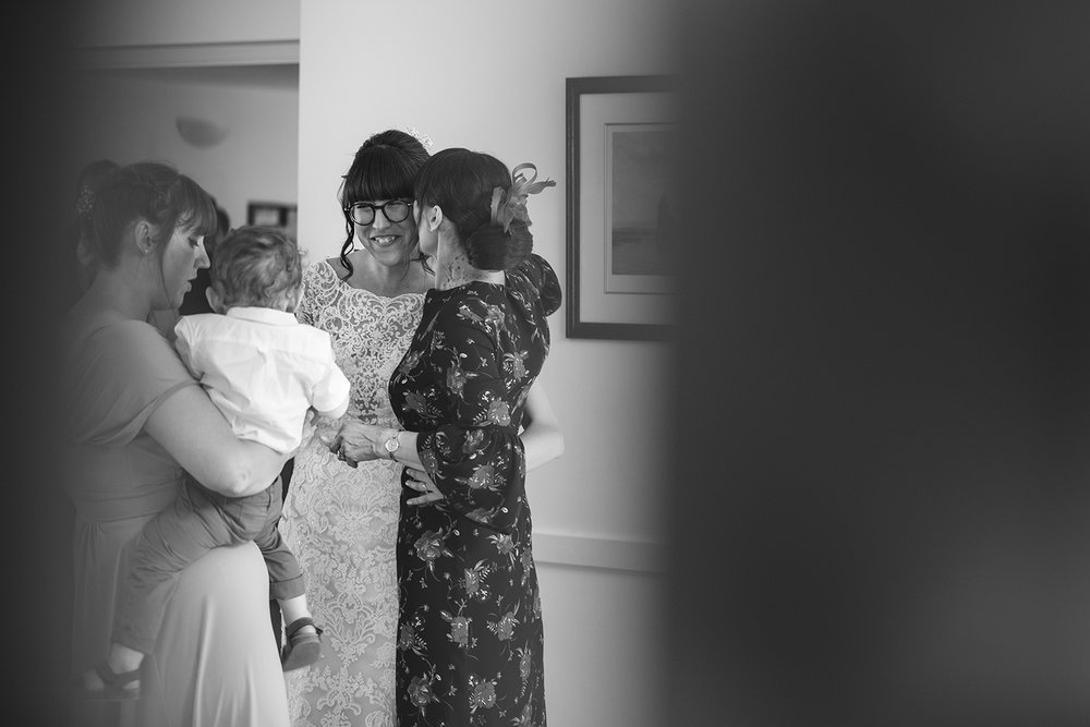 Bride with guests and young child