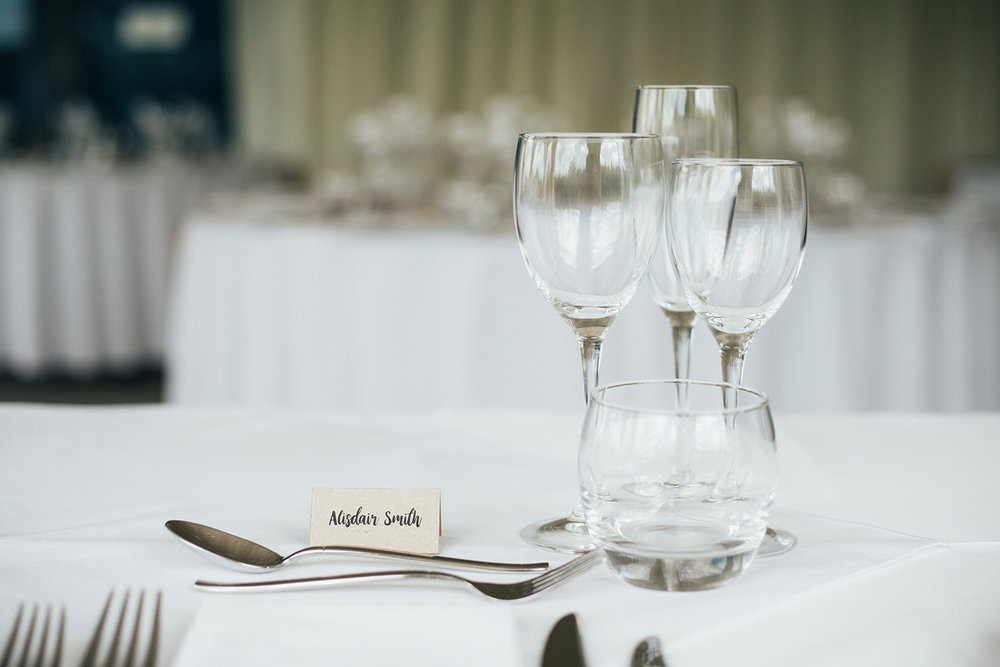 Wine glasses on wedding dining table