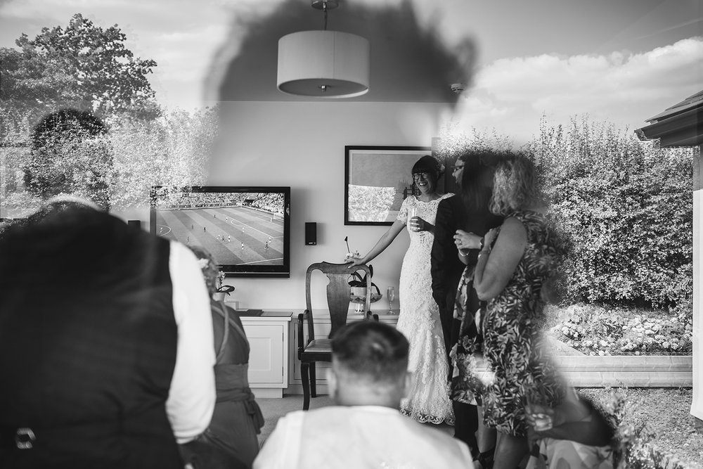 Wedding guests watching World Cup Football