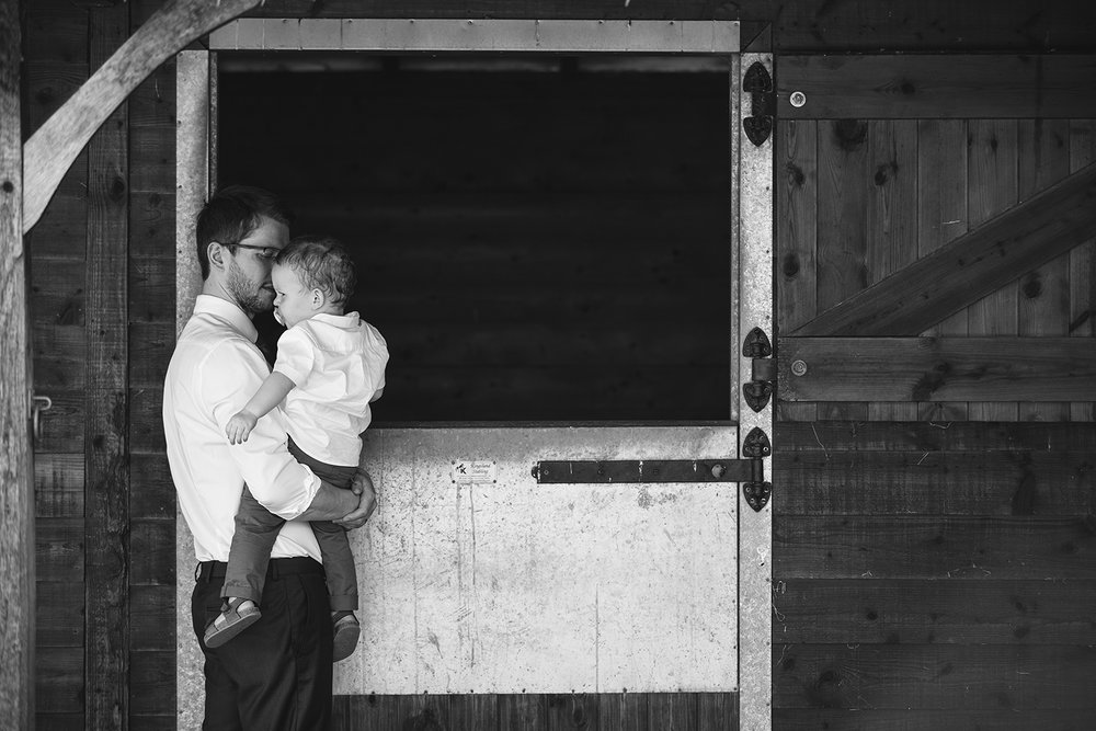 Man and child at stables