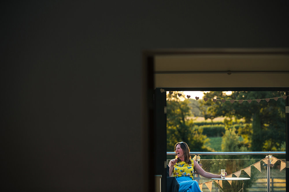 Lady on balcony at wedding reception