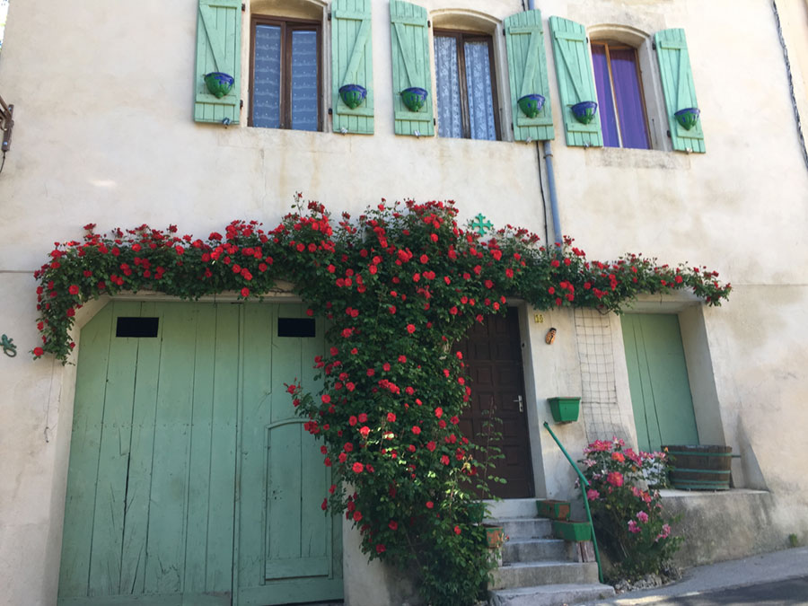 Down every street, you find stone homes lovingly softened by flowers