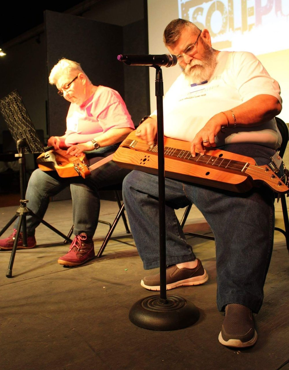 Dennis and Ellen Waldrop, Celebration Dulcimers performing on stage at the annual Sole Purpose event.