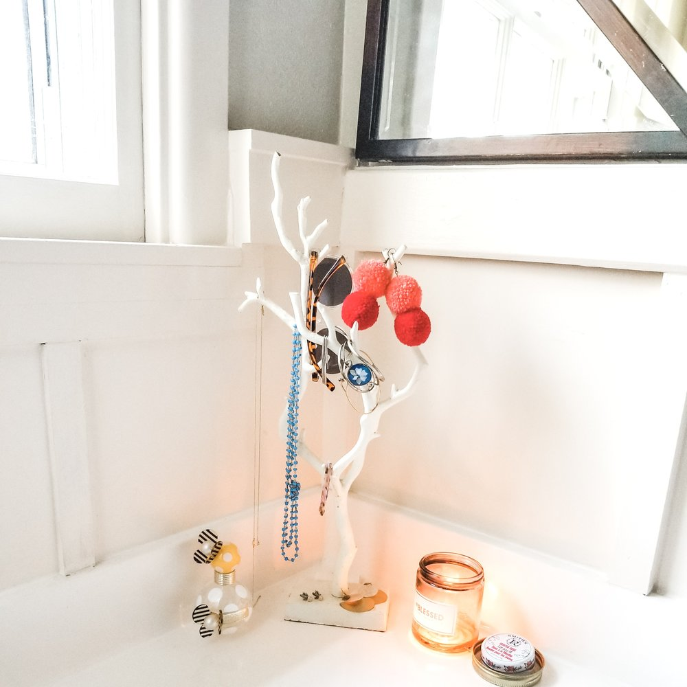 My happy little bathroom nook for jewelry and perfume! The candle I got last fall from  @okcollective  and I absolutely love this sent #BLESSED!
