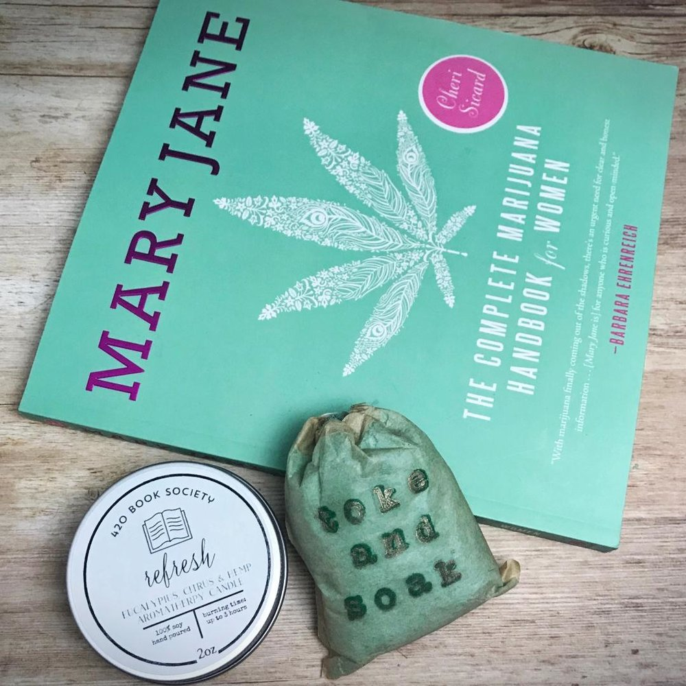"May's membership features ""MaryJane"" by Cheri Sicard, ""The Complete Marijuana Handbook for Women"". This is a fun, practical guide into the stylish and modern world of Cannabis for Women. Learn helpful tips on hosting a pot party, easy edible recipes, beauty products and everything else a women needs to know about MaryJane! Also included in your monthly subscription is an ""Toke and Soak"" Bath Fling handmade by Covet Soap's, an exclusive ""420 Book Society"" hemp infused aromatherapy candle, plus a few more surprises to help you relax & enjoy your Mother's Day!  For more information on this book and others by Cheri Sicard visit  www.cannabischeri.com"