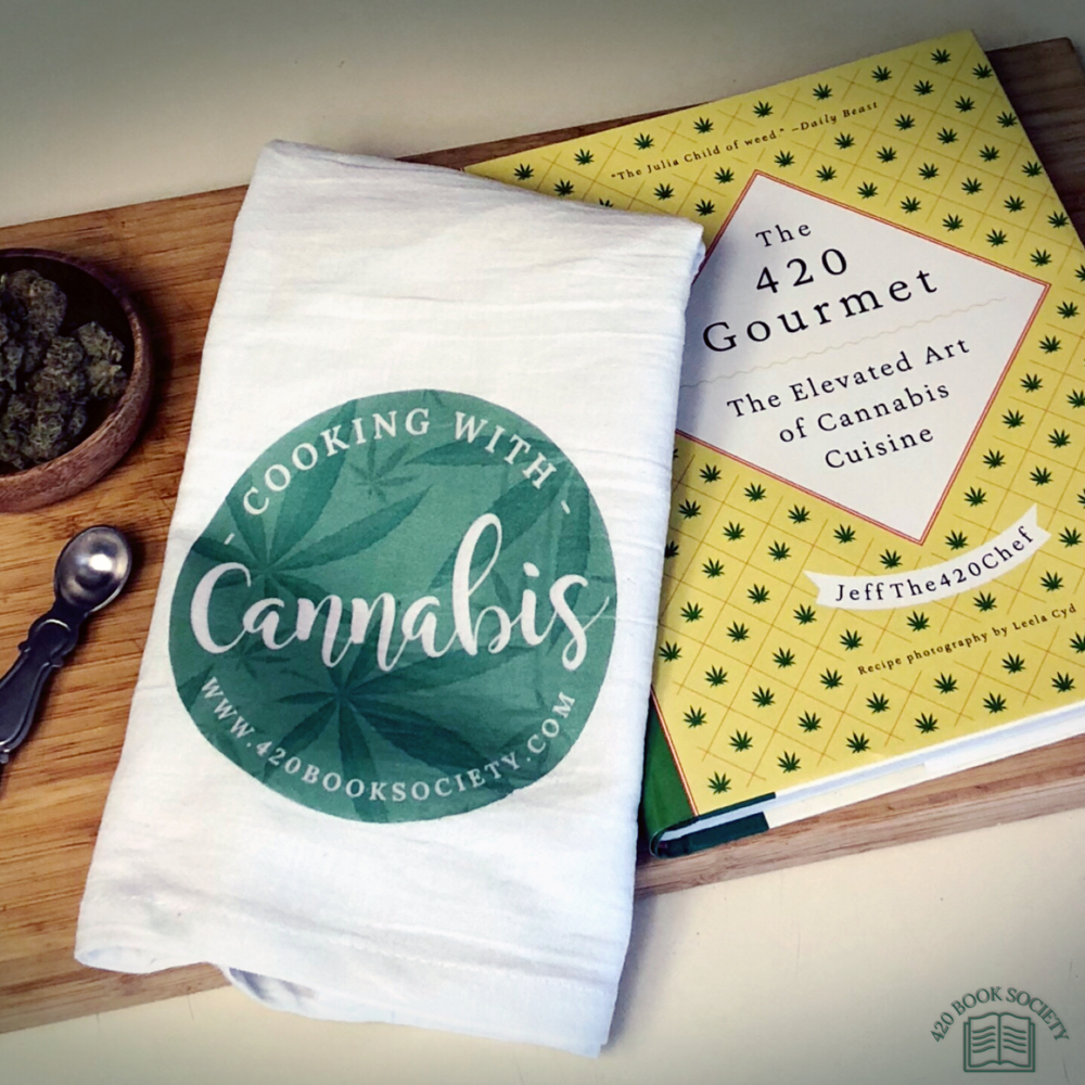 "October 2018      Learn the art & science of cannabis cuisine with October's book of the month ""The 420 Gourmet"" by Jeff the 420 Chef!    Jeff will teach you everything you need to know from choosing the right strain for desired effects, dosing properly & his step by step guide to making ""light-tasting"" canna butter and oils! Perfect for those new to cannabis or if your looking to take your skills to the next level! Plus to help you have fun exploring the art of cannabis cuisine, members will receive our exclusive ""cooking with cannabis"" kitchen towel and keep you lips ""kiss the cook"" ready with Forbidden Leaf hemp lip balm!"