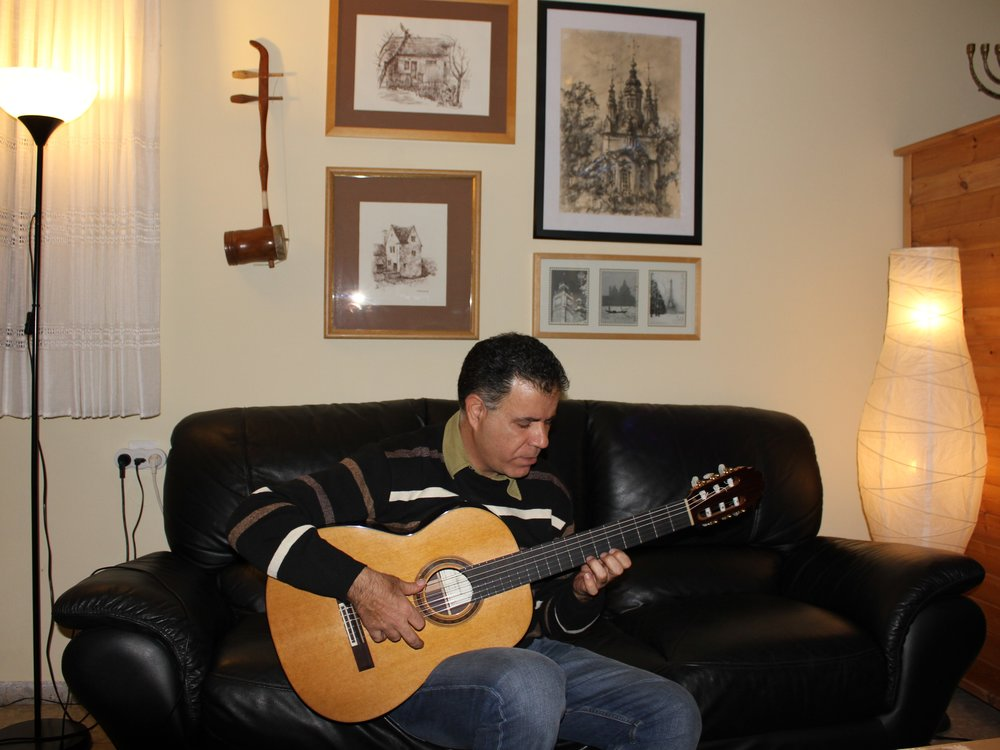 """Yoram Zerbib ,one of the Israeli leading player and teacher, with his 2011 Cedar/Indian Rosewood traditional classical """"Signature"""" model, in my house in Jerusalem, Israel"""