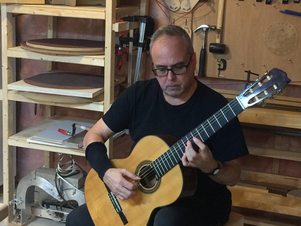 Jeffrey McFadden , professor from University of Toronto,doing some set up for his guitars in my workshop in Waterloo, Canada, 2017