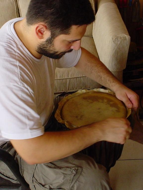 Placing a goat skin on Djembe, Jerusalem, Israel, 2003