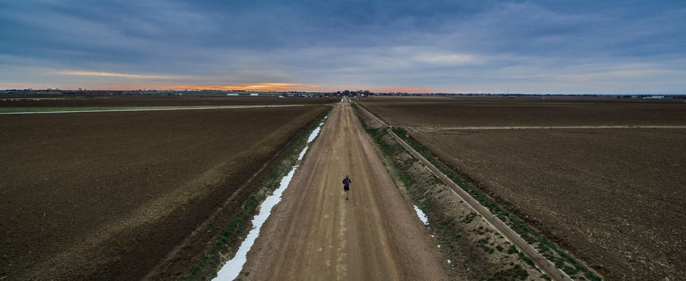 Trev_running on road_aerial (photo by Dustin Etheredge).jpg