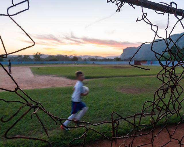 The sun sets over a sports complex in Vinales, while families finish up their sessions. .  www.cubaphototravel.com Engage l Explore l Capture Follow: @cubaphototravel / Tag: #cubaphototravel . . . . . . . #Cuba #loves_cuba #vinales #photographyislife #getlost #keepexploring #theglobewanderer #exploretheworld #neverstopexploring #travelstagram #letsgosomewhere #roamtheplanet #welltravelled #justbackfrom #chasinglight #openmyworld #bestvacations #travelstoke #travelphotographer #traveldeeper #welltravelled #stayandwander #passionpassport