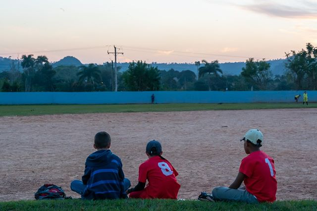 Three boys wait their turn to play baseball in Vinales.  www.cubaphototravel.com Engage l Explore l Capture Follow: @cubaphototravel / Tag: #cubaphototravel  #Cuba #loves_cuba #vinales #photographyislife #getlost #keepexploring #theglobewanderer #exploretheworld #neverstopexploring #travelstagram #letsgosomewhere #roamtheplanet #welltravelled #justbackfrom #chasinglight #openmyworld #bestvacations #travelstoke #travelphotographer #traveldeeper #welltravelled #stayandwander