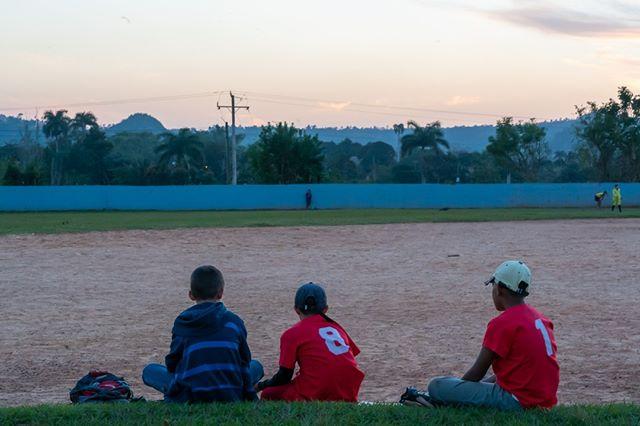Three boys wait their turn to play baseball in Vinales.  www.cubaphototravel.com Engage l Explore l Capture Follow: @cubaphototravel / Tag: #cubaphototravel  #Cuba #loves_cuba #vinales #photographyislife #getlost #keepexploring #theglobewanderer #exploretheworld #neverstopexploring #travelstagram #letsgosomewhere #roamtheplanet #welltravelled #justbackfrom #chasinglight #openmyworld #bestvacations #travelstoke #travelphotographer #traveldeeper #welltravelled #stayandwander