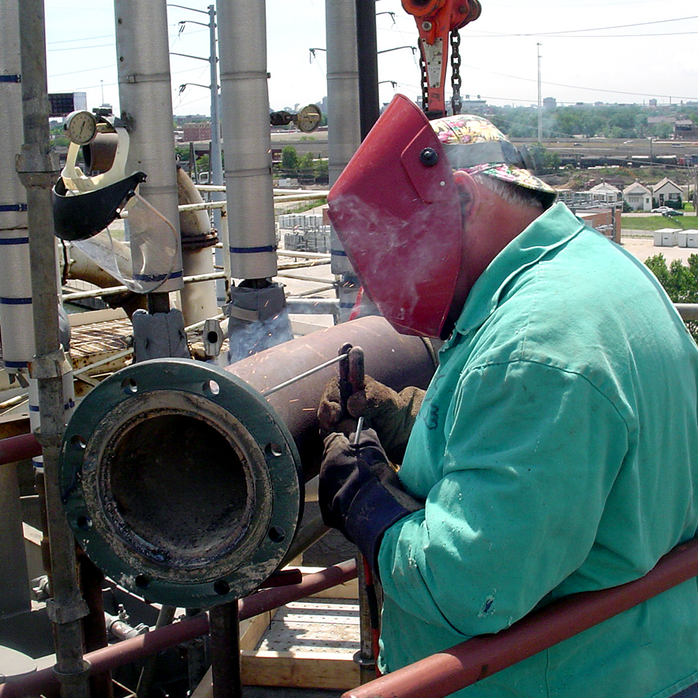 Welding-on-Hydrobin-Piping-at-Fisk-Staion.jpg