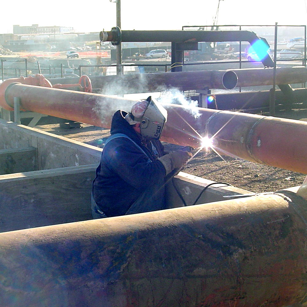 Welding-on-Settling-Pond-Piping-at-Fisk-Station.jpg