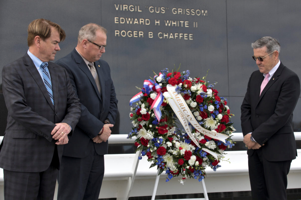 During the 2018 Day of Remembrance at NASA's Kennedy Space Center, from left, State Sen. Thad Altman, president and CEO of the Astronauts Memorial Foundation, Therrin Protze, chief operating officer of Delaware North, and Center Director Bob Cabana place a wreath at the Space Mirror Memorial. Photo credit: NASA/Kim Shiflett