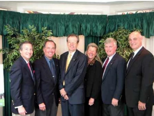 L to R: Stephen Feldman, president of the AMF; Bob Crippen, astronaut and AMF board member; Charles Geach, 2004 Alan Shepard Technology in Education Award winner; Laura Shepard Churchley, Alan Shepard's daughter; James Kennedy, center director of the Kennedy Space Center; and Bob Henry, chairman of the AMF, corporate senior vice president of the Harris Corporation and president of the government communications systems division of the Harris Corporation on May 2, 2004.