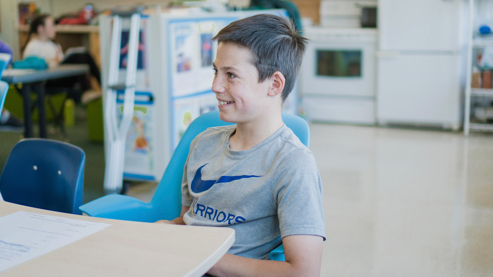 student smiling in class banner.jpg