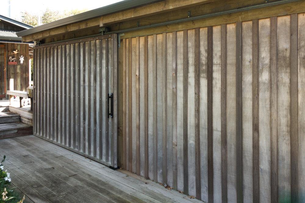 DividingDoor - Sliding door we fabricated for a clients outdoor entertainment area.