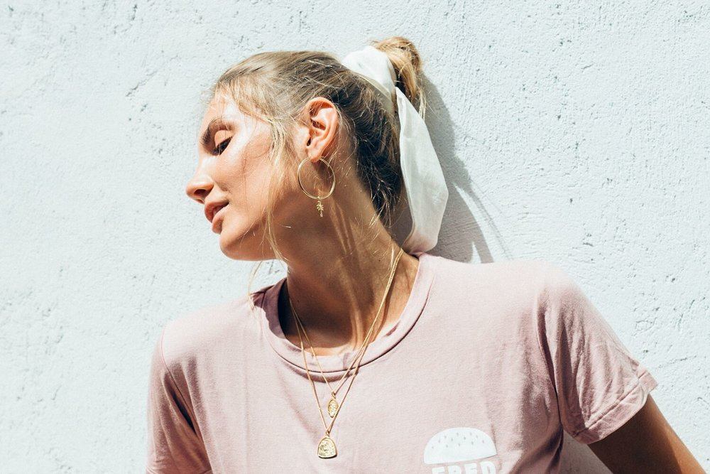 Necklaces from the  Santa Chiara  collection and Palm charm earring | PC: La Luna Rose