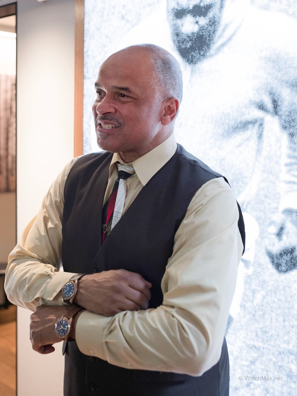 Carl Brashear's son: Philip, posing wearing both limited edition Oris diver bronze with a photo of the Master Diver in the background.