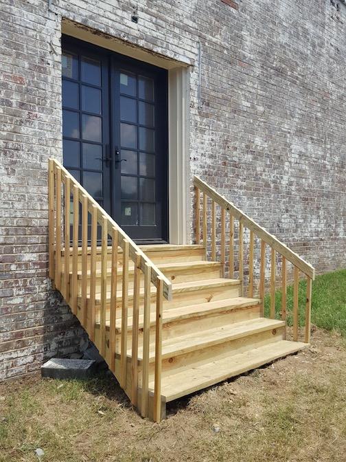 The new back door and stairway go in!