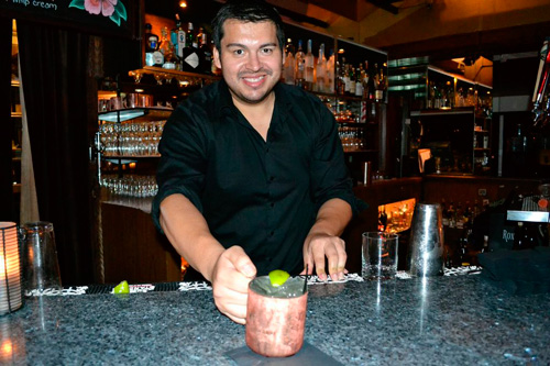 bartender serving moscow mule