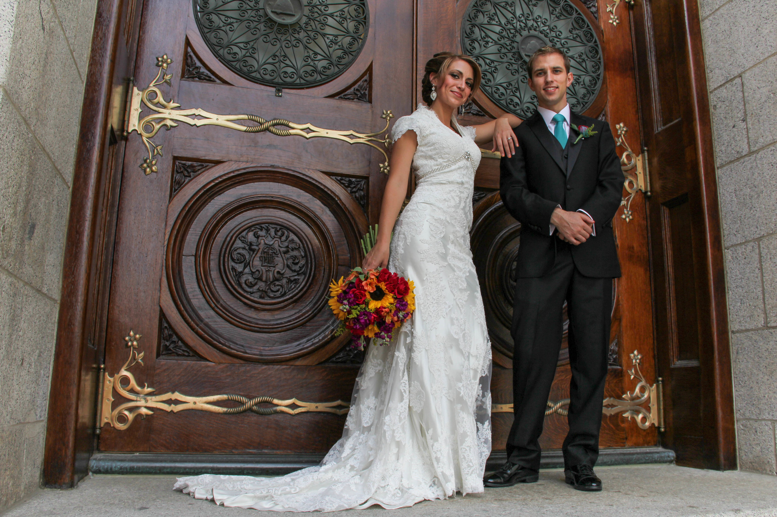 Wedding couple pose for wedding photo at the Salt Lake Temple