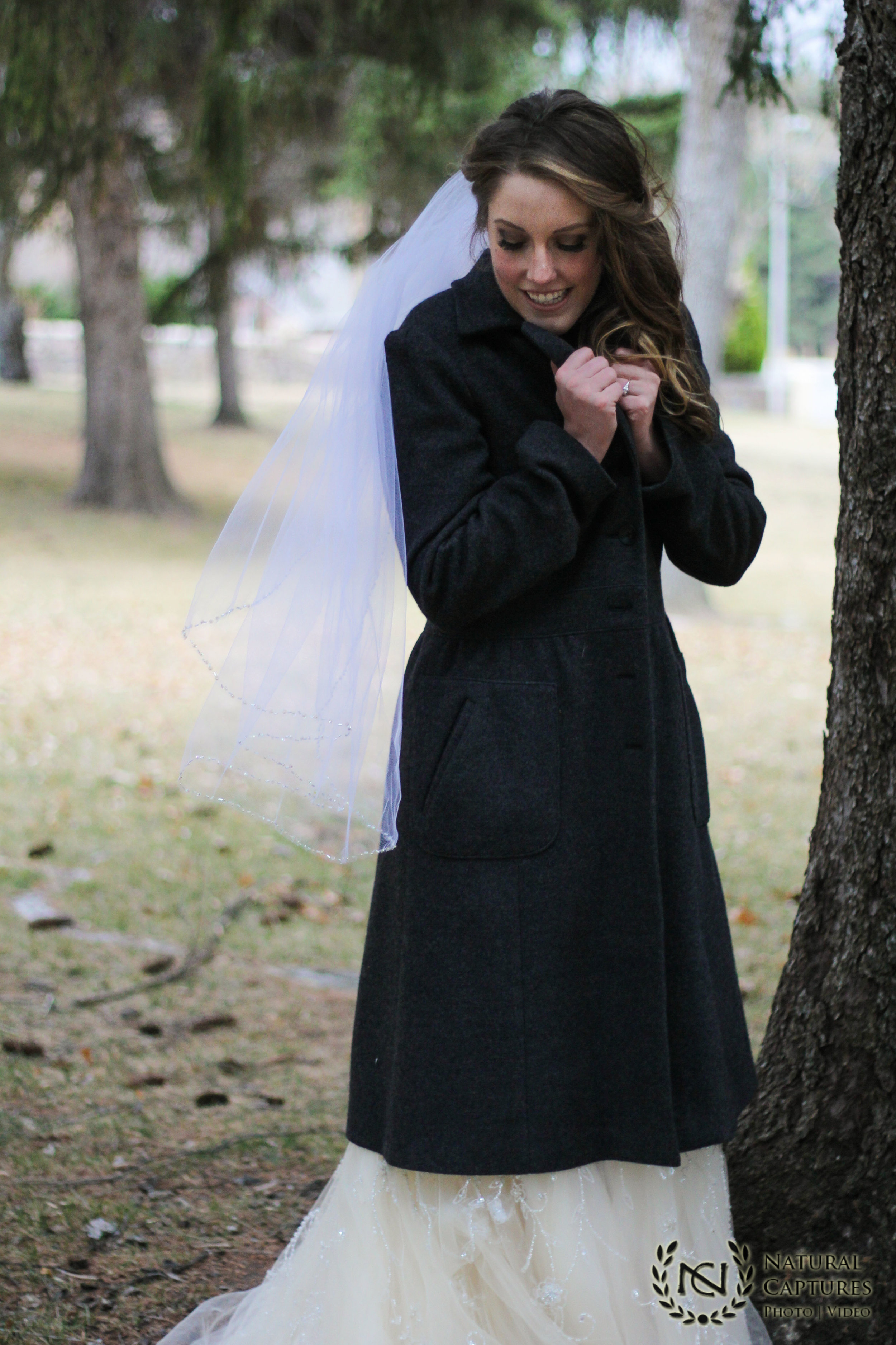 Bride in groom's coat - wedding photo