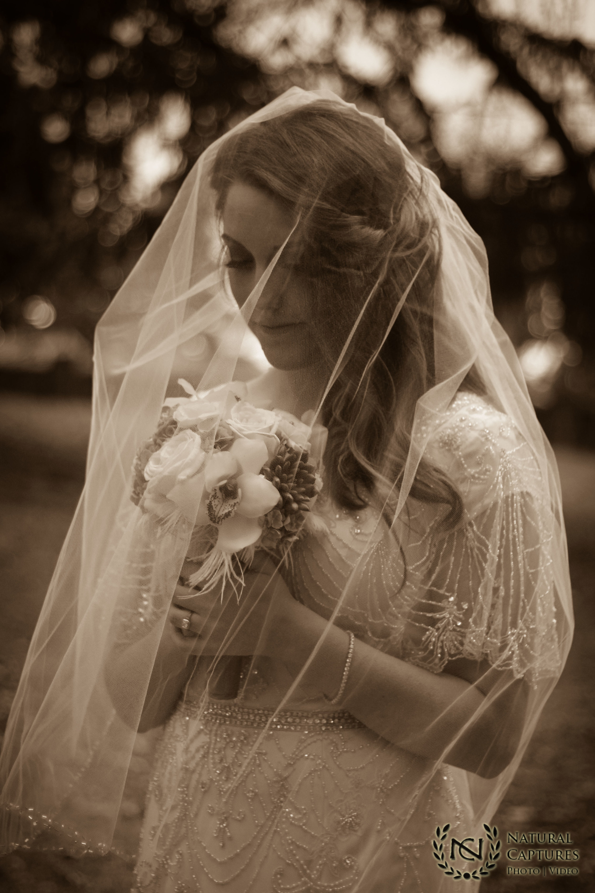 Veiled bride photo - sepia