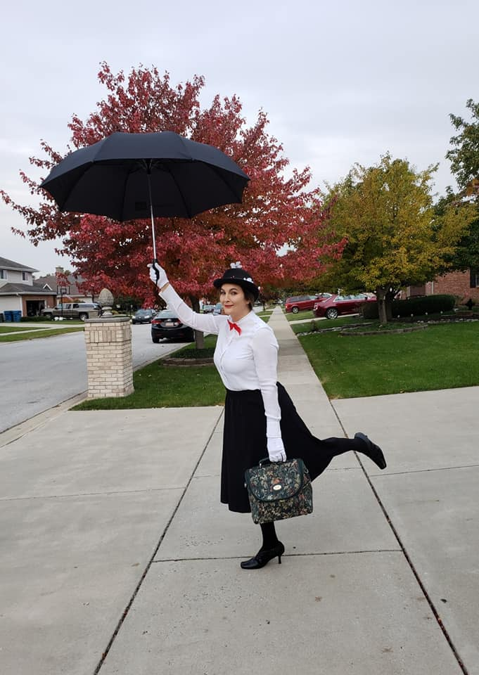 Mary Poppins Costume   White dress shirt with no collar  Red bow (I used a Christmas bow)  Over-the-knee black skirt  Black tights  Black shoes  White gloves  Black hat with flowers and berries from the craft store  Black umbrella  Old bag  Red lipstick
