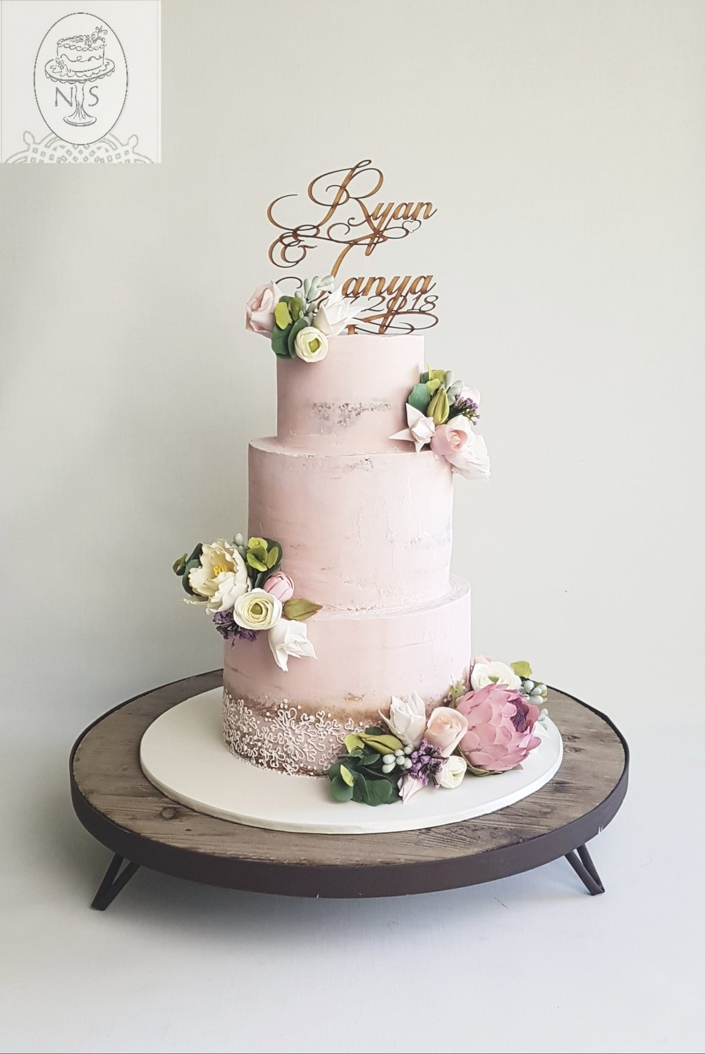 Nicky Svensen Cakes - Completely self-taught, I began making cakes about eight years ago, focusing predominantly on wedding cakes in the last couple of years. My cakes are 'baked from scratch' using quality ingredients as it's really important to me that my cakes taste as good as they look. My specialty is creating beautiful lifelike sugar flowers and foliage which feature in most of my cakes. The process of designing a wedding cake usually starts when I sit down with the couple many months before the wedding and, for me, there's nothing more satisfying than seeing the design become a reality on their big day.https://www.facebook.com/nickysvensencakes/https://www.instagram.com/nickysvensencakes
