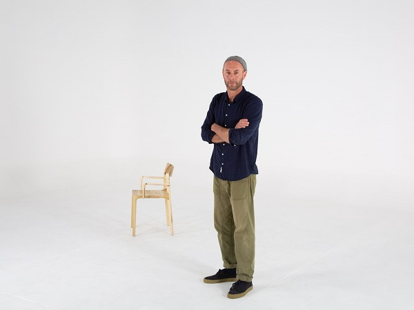 Adam Goodrum with the Molloy Chair available through  Cult Design