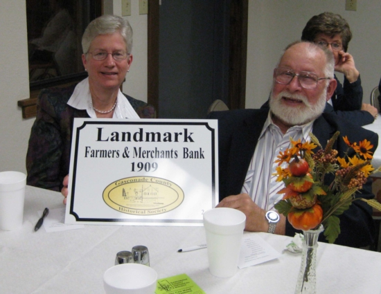 Lois Puchta and Horace Hesse display the Landmark plaque that was awarded to The  FARMERS & MERCHANTS BANK  of Hermann, Missouri at our 7 November 2010 membership dinner meeting in Bem.
