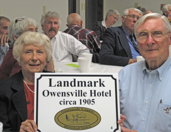 Shirley and Herb Lindroth display the Landmark plaque that was awarded to The  OWENSVILLE HOTEL  of Owensville, Missouri at our 7 November 2010 membership dinner meeting in Bem.