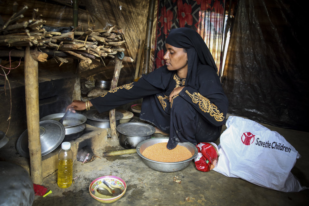 Photo caption: Morium* preparing lunch for her family with the aid she received from Save the Children. Photo credit: Save the Children. Date: January 2018.