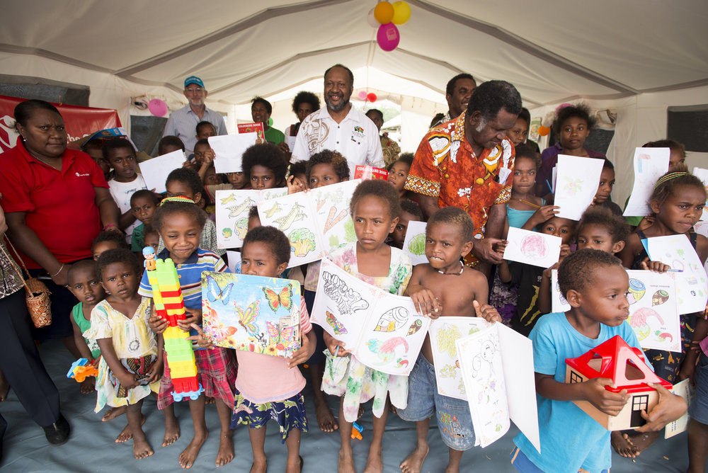 Photo caption: Prime Minister Charlot Salwai visits Save the Children's Child Friendly Space in Chapuis Stadium. He spent time talking to children and staff, and stressed the importance of children maintaining their schooling. Photo credit: Save the Children.