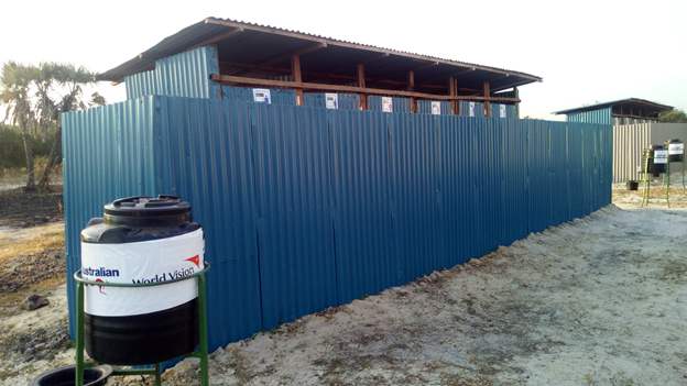Completed institutional latrine with hand washing facilities in Koch County.png