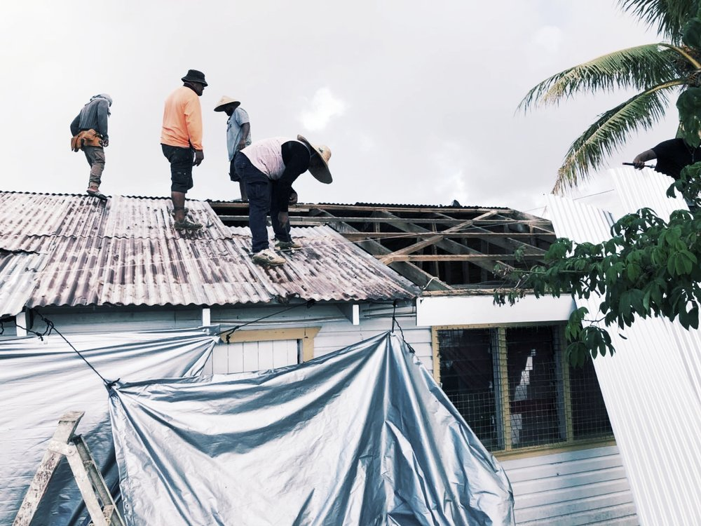 Roof repairs following Tropical Cyclone Gita © CARE Australia