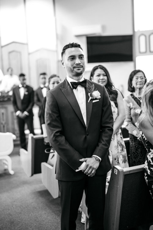 groom waiting for bride walking down the aisle