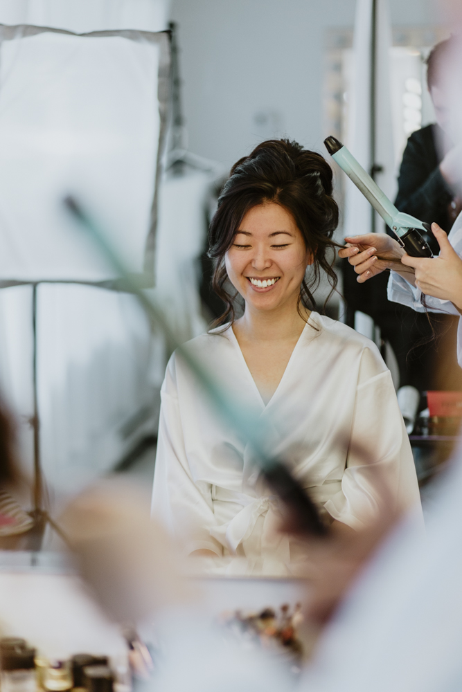 bride waiting for her hair to be done